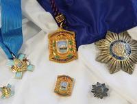 Domina / Medalla